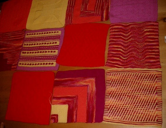 Orange, burgundy, variegated and yellow yarns knitted into squares and laid out on a table