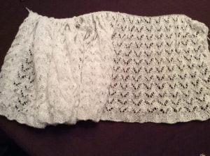 A froth of white on the left, with the right side laid out to show the horseshoe lace.