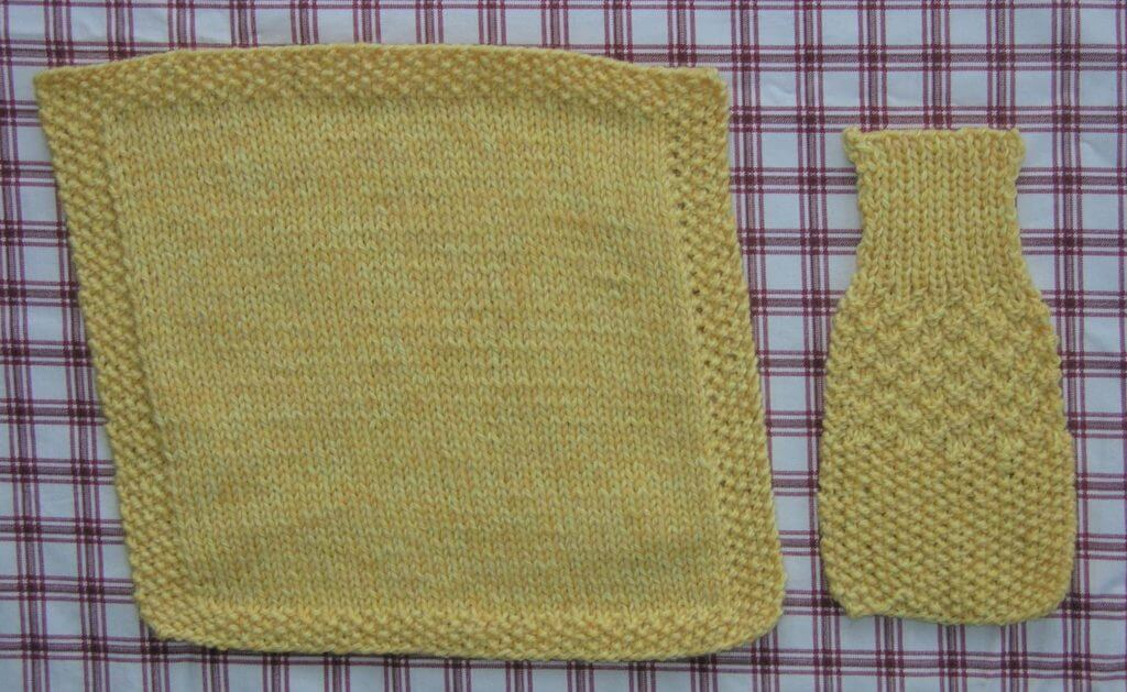 Two yellow swatches of knitting on a checked background. The left sample, done in stocking stitch, skews upward to the left. The right sample has sections of seed stitch, double seed stitch, and ribbing, and it aligns perfectly with the checks on the background!